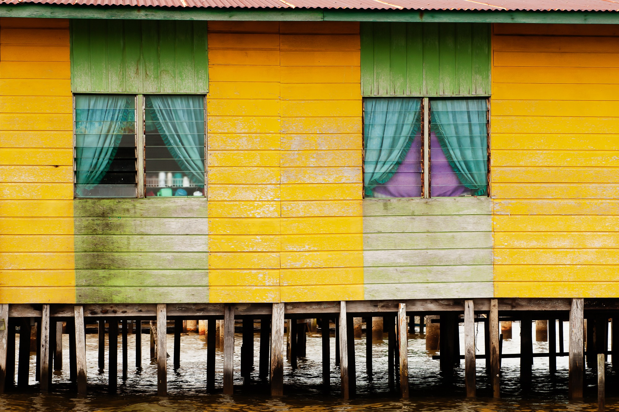 brunei yellow house on the water